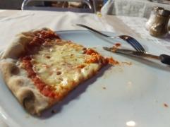 Last pizza slice in Italy...sigh...